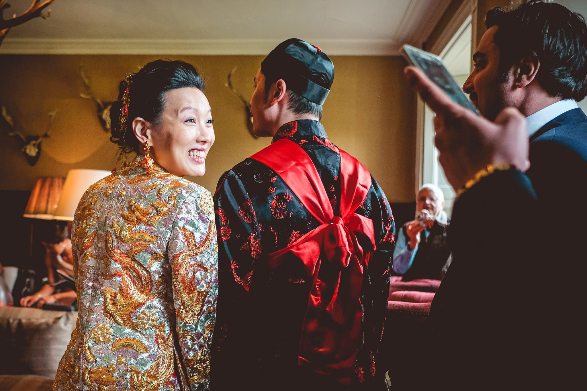 Bride and groom and Chinese wedding ceremony at a Babington House wedding in Somerset