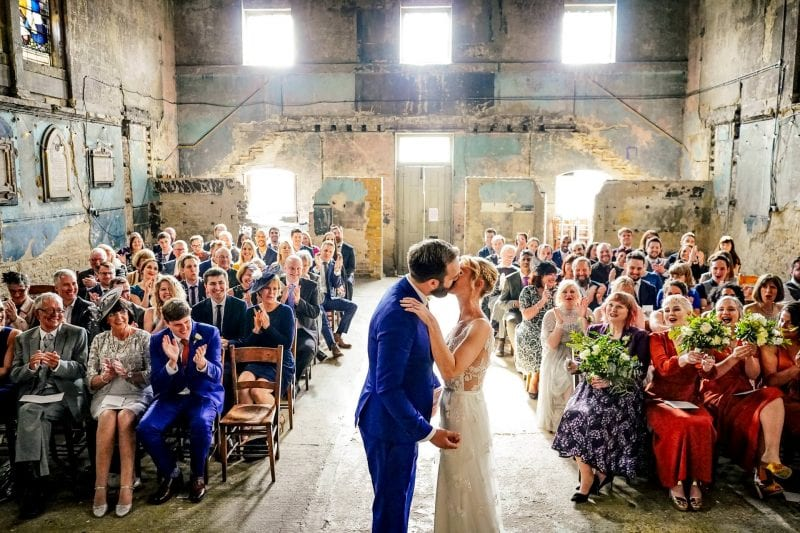 Bride and Groom's first kiss at an Asylum Chapel wedding in London