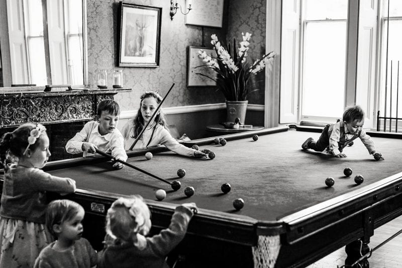 Kids playing on the snooker table at a Penton Park wedding