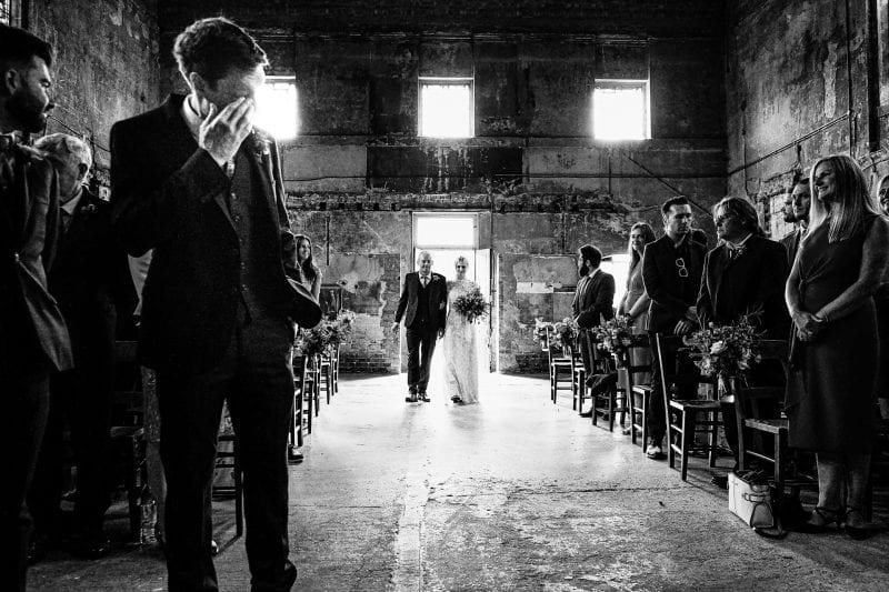 Groom crystal as bride walks down the aisle at a wedding at Asylum Chapel in Peckham London