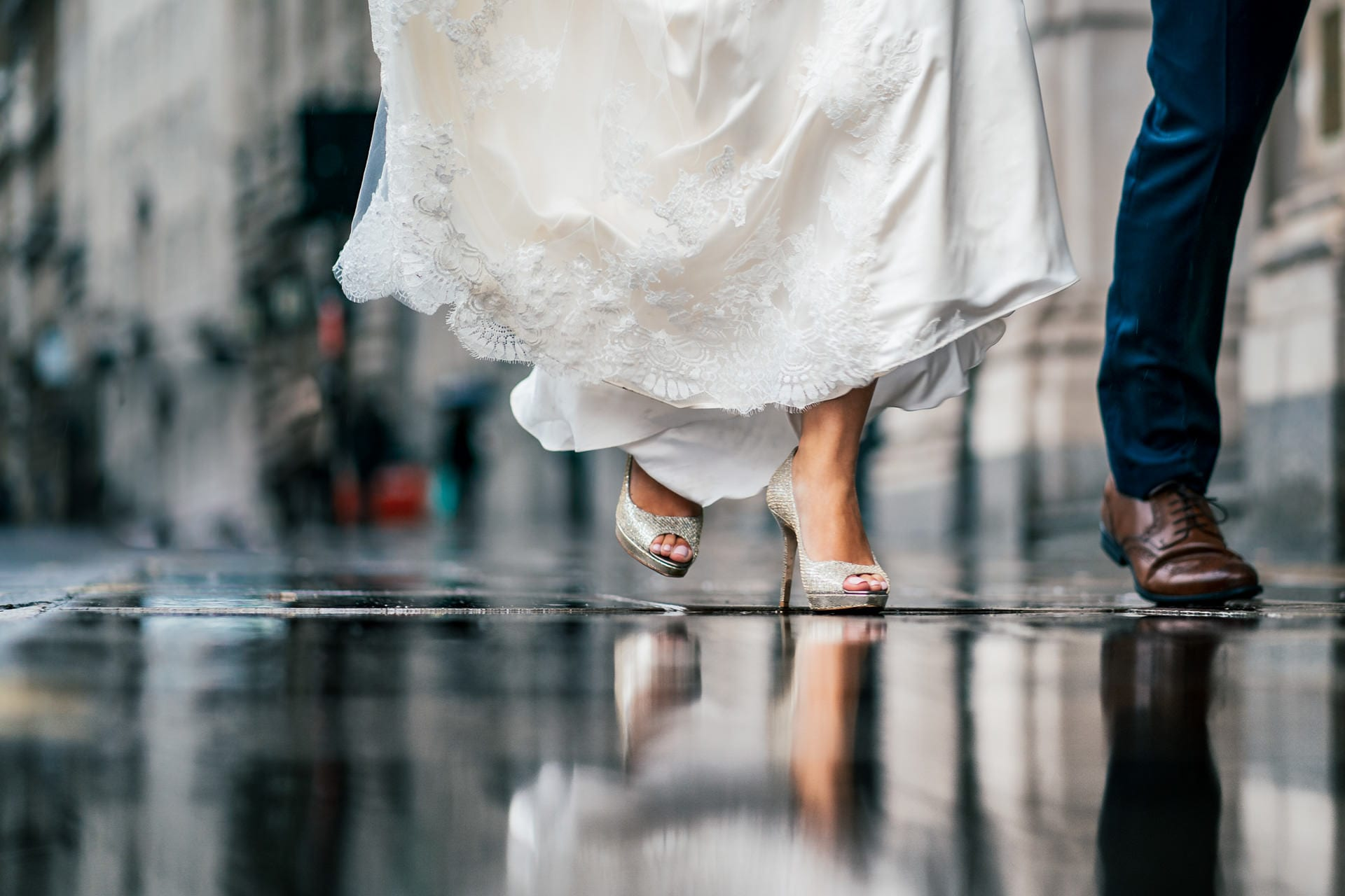 Bride's wedding shoes on rainy streets at a wedding at 1 Lombard Street in London