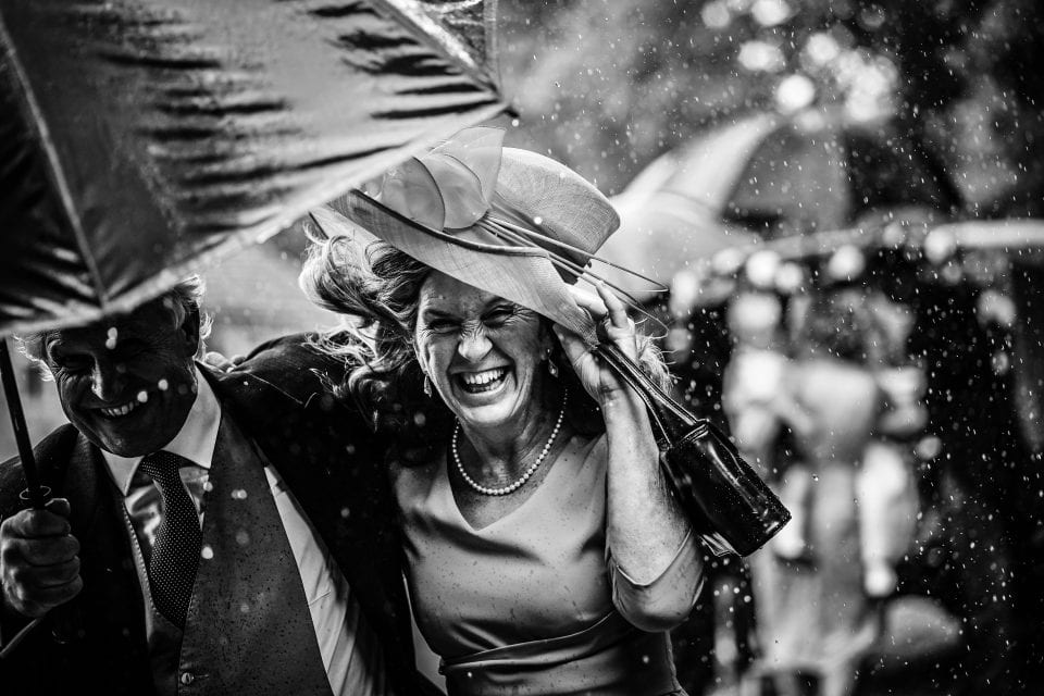 Mum rushes to the church on a wet wedding day