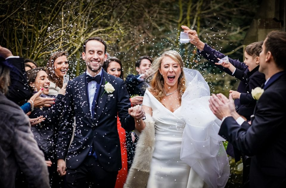 Bride and Groom and confetti at Hampton Manor
