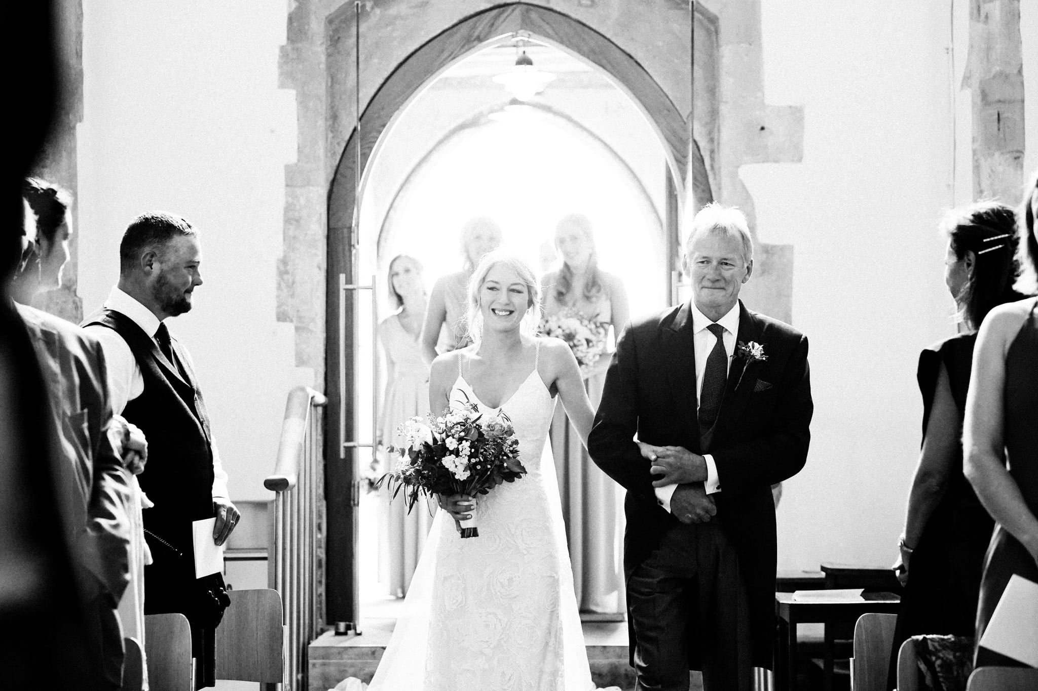 Bride walking down the aisle at a Long Crendon wedding in Buckinghamshire