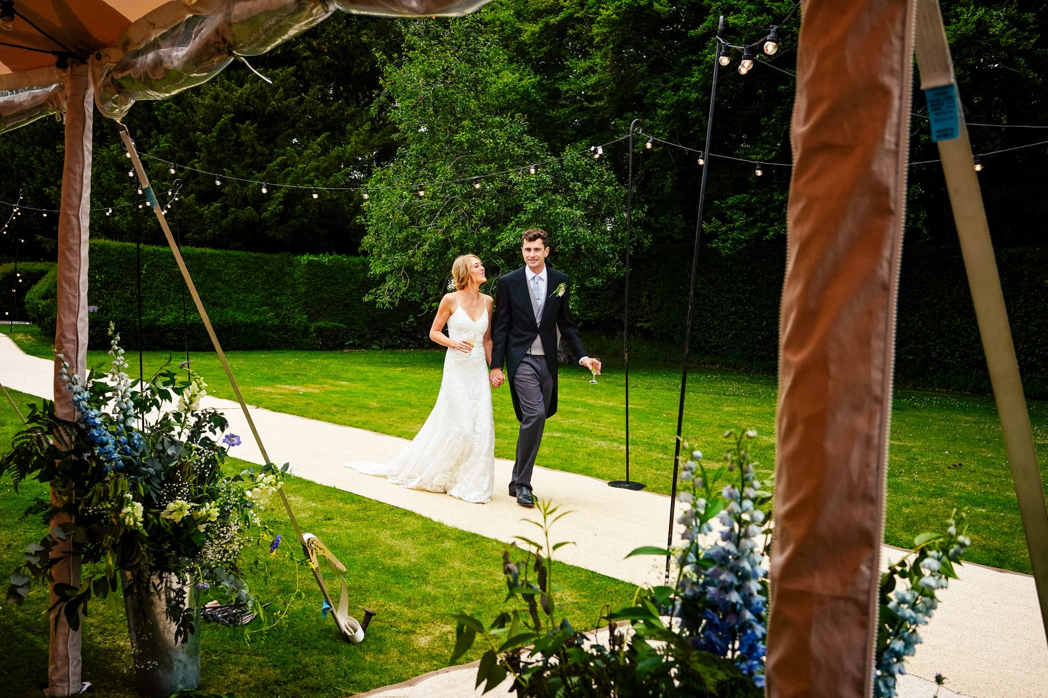 Bride and groom walking into the marquee at a Long Crendon wedding in Buckinghamshire