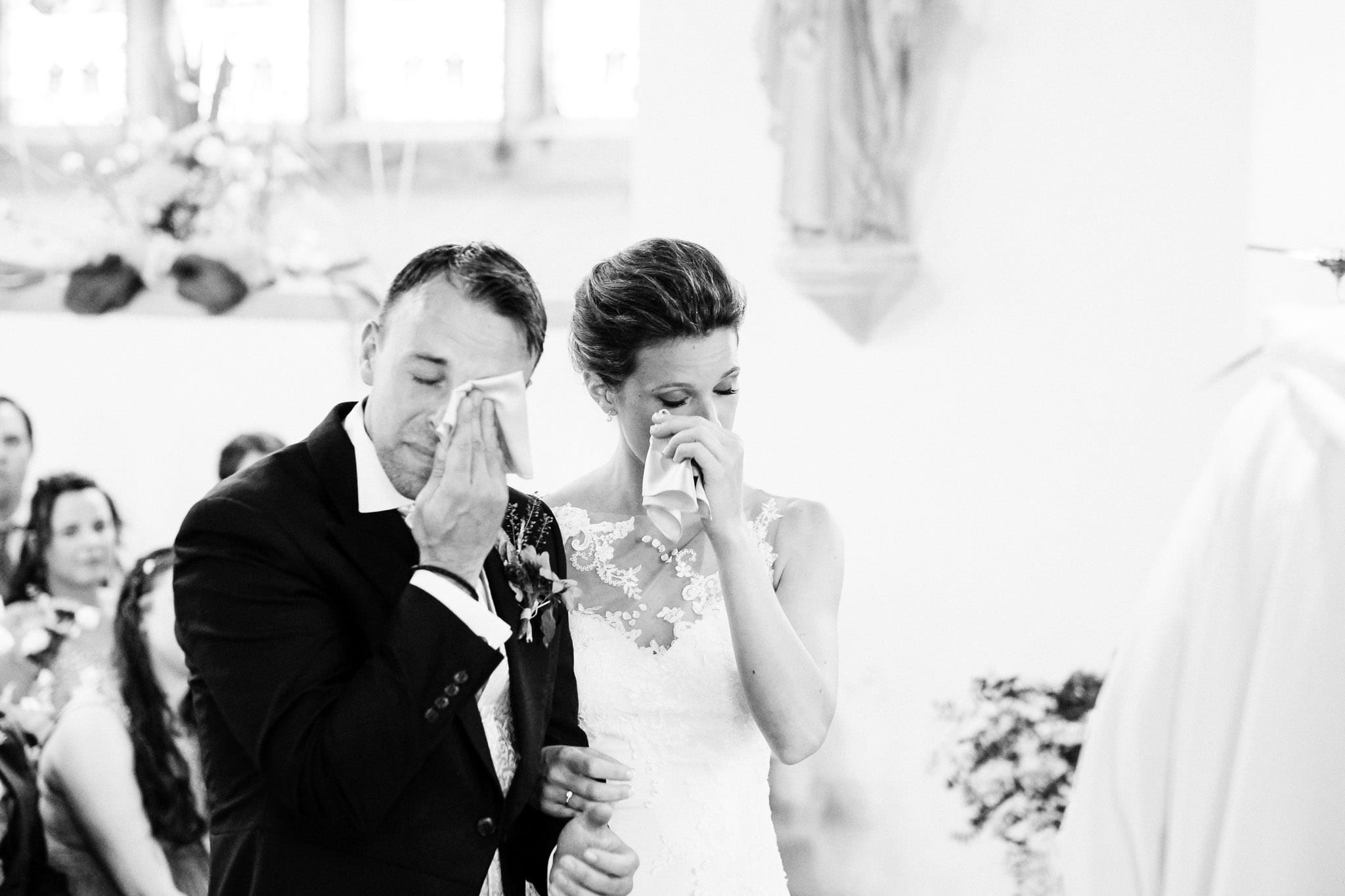 Bride and groom crying during the ceremony at an East Sussex wedding