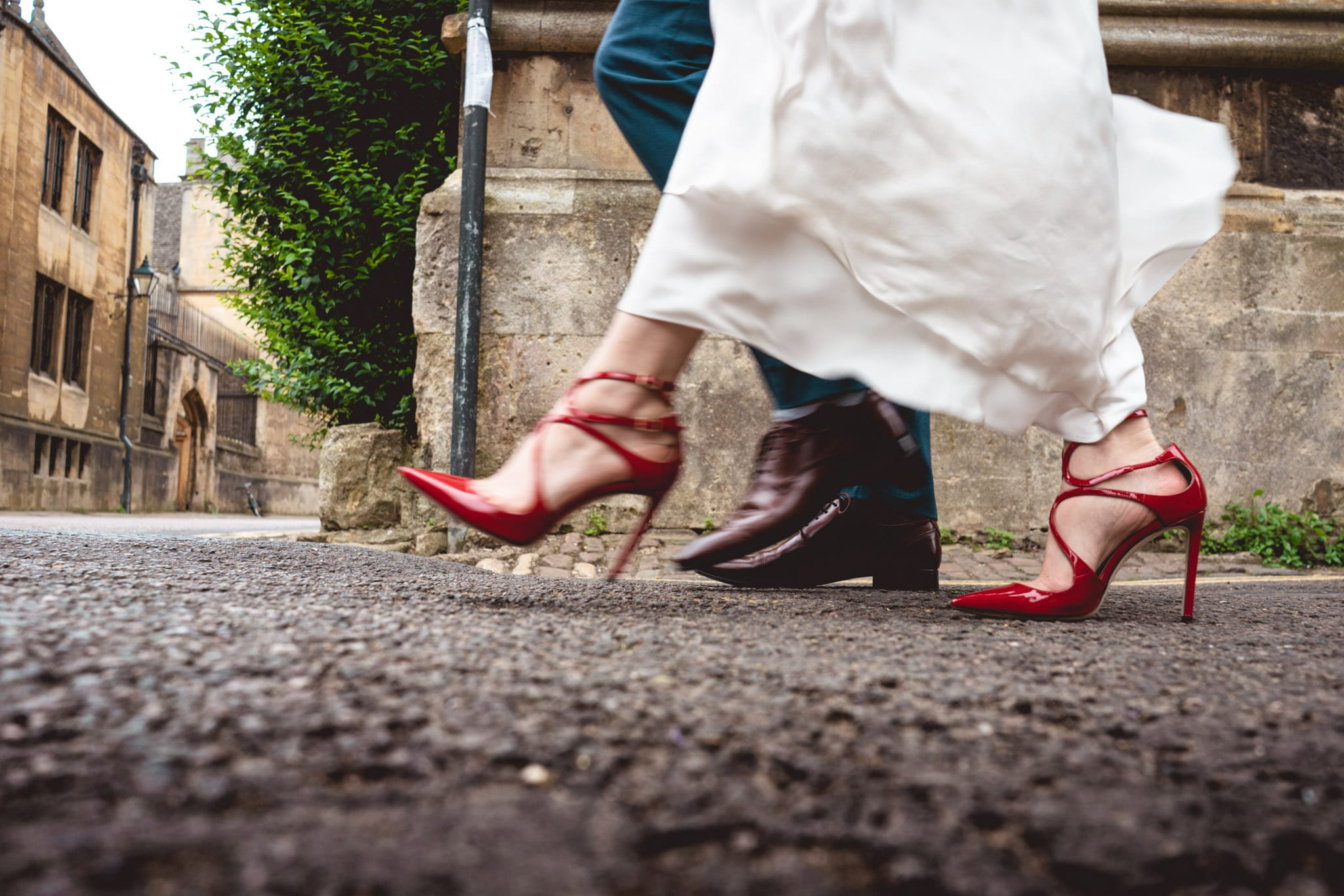Bride and groom walking to their Oxford wedding venues