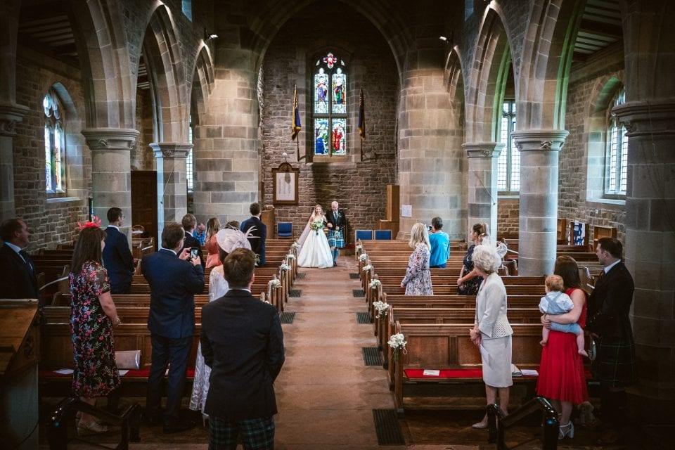 Bride and Father walk down the aisle at a socially distanced wedding in The Lakes