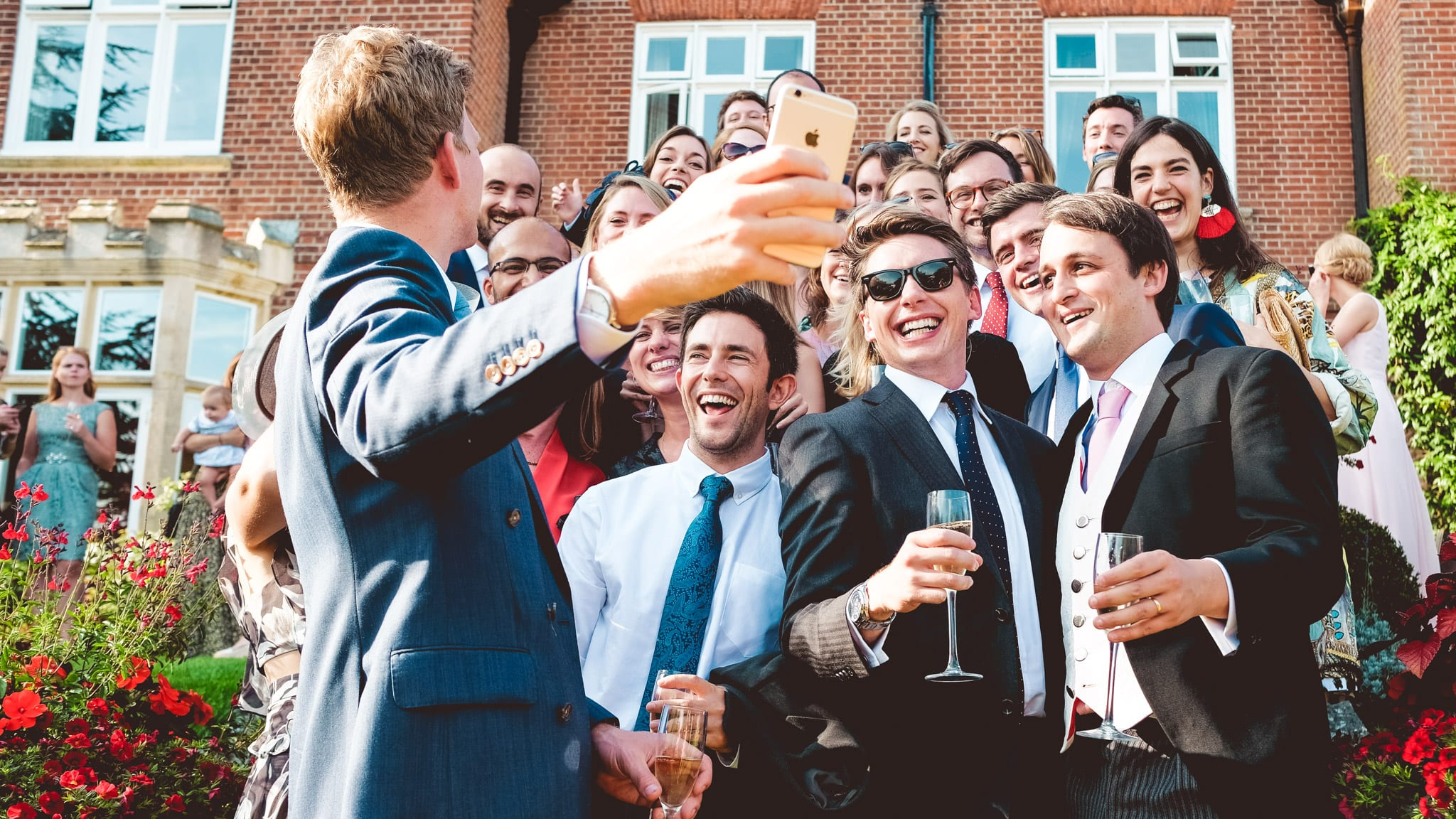 Setting up a wedding selfie with guests