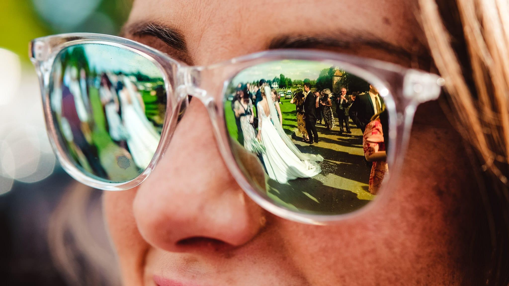 Bride reflected in sunglasses
