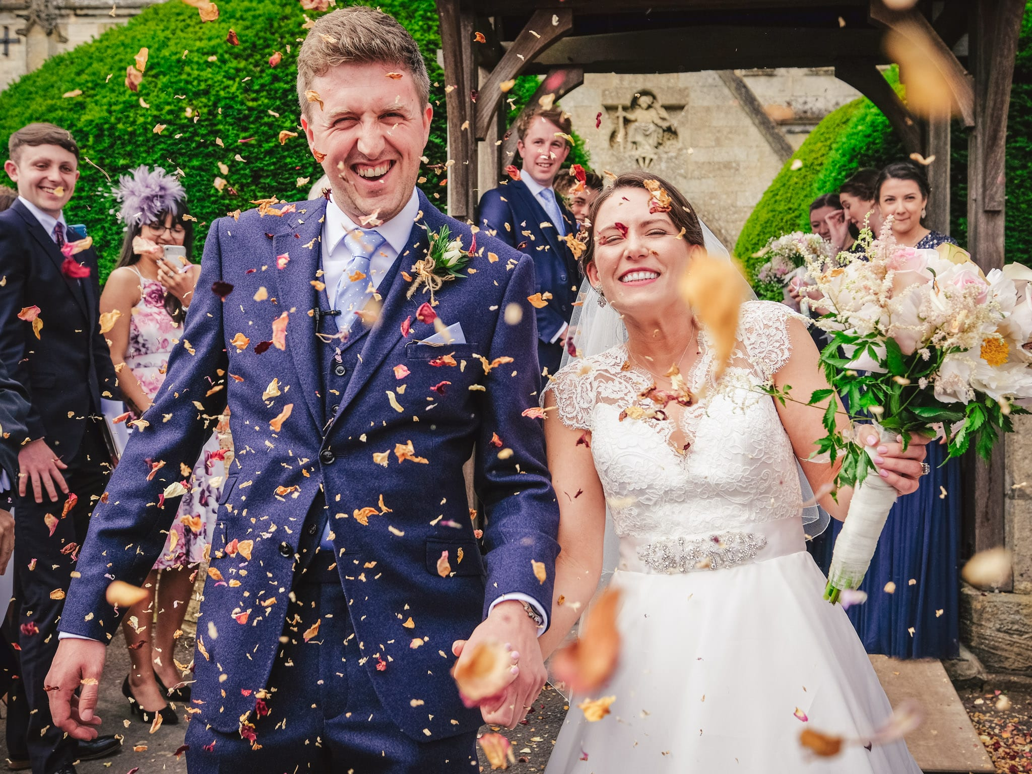 Bride and groom and confetti shower