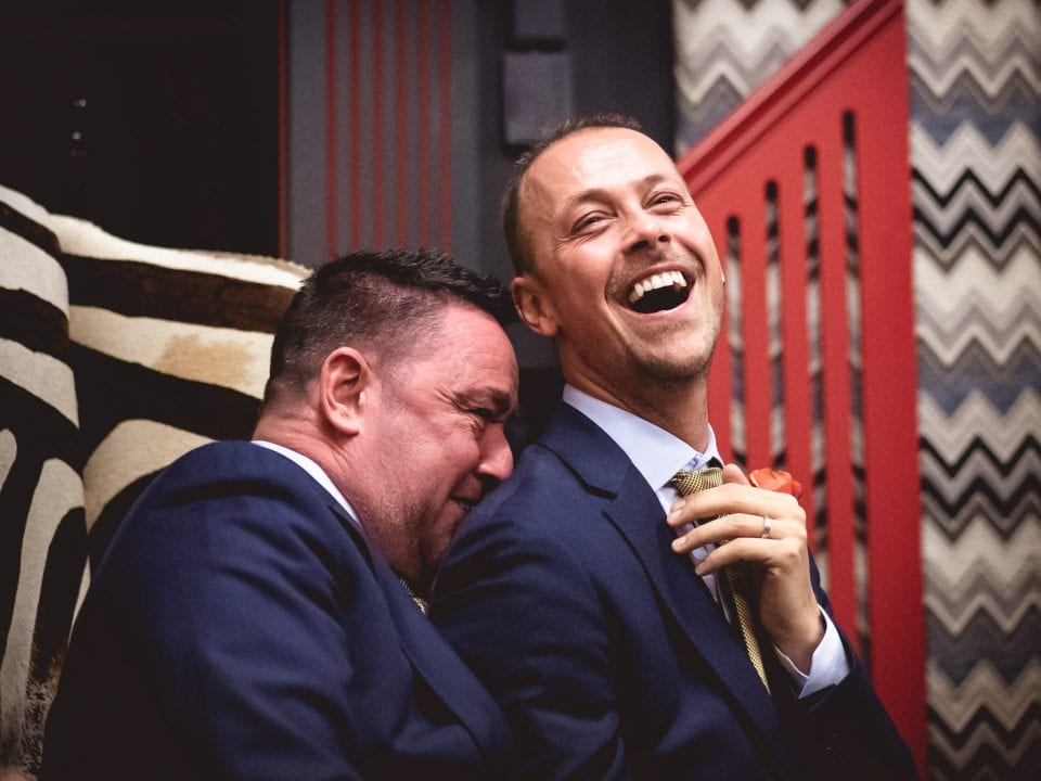 The Grooms laughing at a gay wedding in London